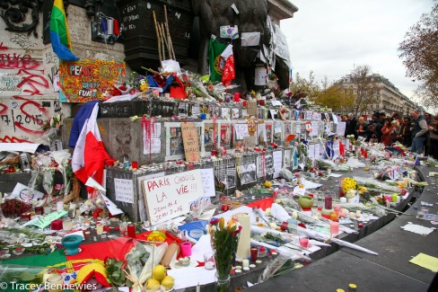 Pages from Charlie Hedbo still line the base of the statue of Marianne at Place de la Reépublique.